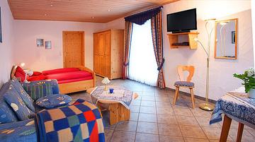 Bild:Gästehaus Ingrid Schlaf- und Wohnbereich